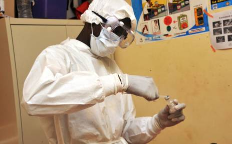 FILE: A health worker prepares a vaccination at a health centre in Conakry during the first clinical trials of the VSV-EBOV vaccine against the Ebola virus. Picture: AFP