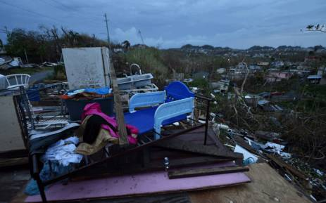 Debris is scattered around a destroyed house in the Acerolas neighbourhood, in Toa Alta, Puerto Rico, on 1 October 2017. Picture: AFP.