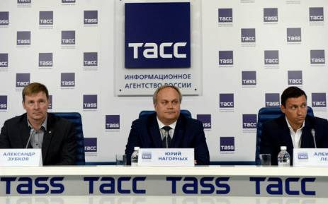 FILE: Two-time gold medal winner at the 2014 Sochi Winter Olympics, Russia's bobsledder Alexander Zubkov, Russia's Deputy Minister of Sport Yury Nagorny and gold and silver medalist at the 2014 Sochi Winter Olympics, Russia's cross country skier Alexander Legkov look on during a press conference on 13 May 2016 in Moscow. Picture: AFP.