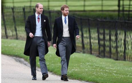 FILE: Britain's Prince William and Prince Harry walk to the church for the wedding of Pippa Middleton and James Matthews on 20 May 2017. Picture: AFP