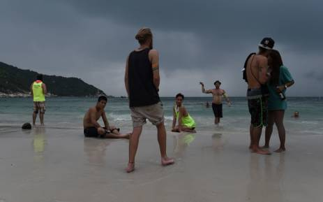 FILE: Partygoers on Haad Rin beach the morning after a Full Moon Party on the southern island of Ko Phangan, Thailand. Picture: AFP