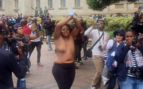 Wits University student goes topless as she pleads with police to cease fire on 4 October, 2016. Picture: Clement Manyathela/EWN.