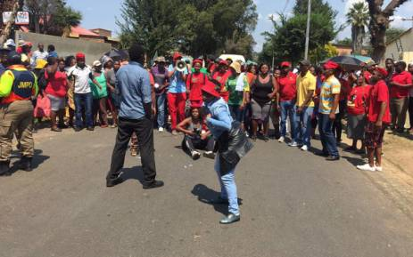 Turffontein community members protest against foreign nationals who they suspect of acquiring properties illegally. Picture: Pelane Phakgadi/EWN.