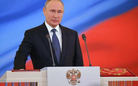 Vladimir Putin takes the oath of office during a ceremony at the Kremlin in Moscow on 7 May 2018 after being re-elected as president. Picture: AFP