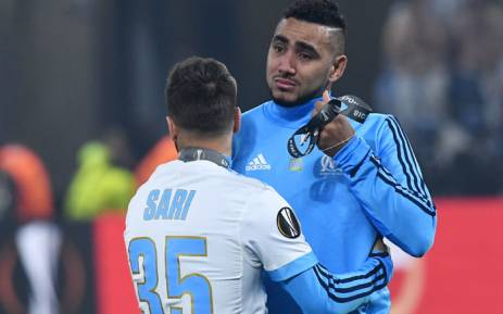 Marseille forward Dimitri Payet (R) is comforted by a teammate after being defeated by Atletico Madrid in the UEFA Europa League final at the Parc OL stadium in Decines-Charpieu, near Lyon on 16 May, 2018. Picture: AFP