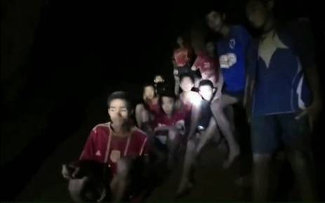 This handout video grab taken from footage released by The Royal Thai Navy late 2 July 2018, shows missing children inside the Tham Luang cave of Khun Nam Nang Non Forest Park in the Mae Sai district of Chiang Rai province. Picture: AFP.