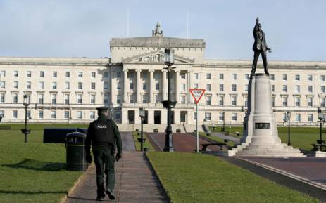 A policeman patrols the Parliament Buildings on the Stormont Estate, the seat of the Northern Ireland assembly, in Belfast on 12 February 2018. Picture: AFP