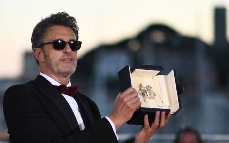 Polish director Pawel Pawlikowski poses with the trophy on 19 May 2018 during a photocall after he won the best director prize for the film 'Zimna Wojna (Cold War)' at the 71st edition of the Cannes Film Festival in Cannes, southern France. Picture: AFP.