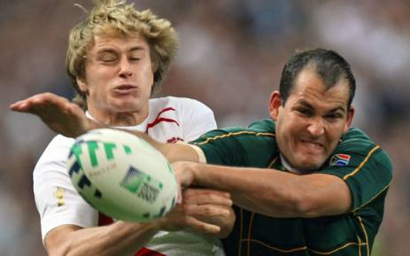 Springbok scrumhalf Fourie du Preez (right) makes life hard for his England opponent during their 2007 Rugby World Cup match. Picture: AFP