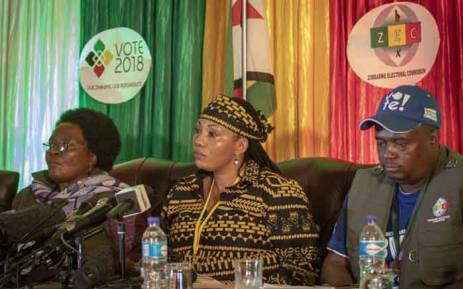The Zimbabwean Electoral Commission, led by chairperson Priscilla Chigumba (C), addressing the media on initial results and voter turnout. Picture: Thomas Holder/EWN