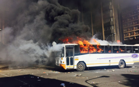 """A bus has been set alight during Fess Must Fall protests as Wits students continue protesting. Picture: Ziyanda Ngcobo/EWN."""""""
