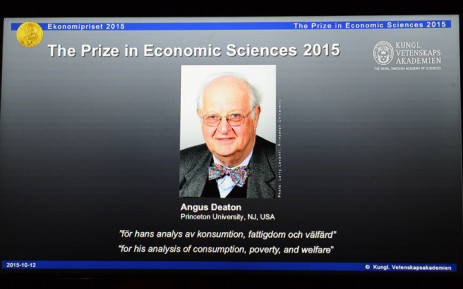 A portrait of US-British winner of the 2015 Nobel Economics Prize Angus Deaton is displayed on a tablet screen during a press conference at the Royal Swedish Academy of Sciences on October 12, 2015 in Stockholm. The economics prize is the only Nobel not originally included in Alfred Nobel's last will and testament. It was established in 1968 by the Swedish central bank to celebrate its tricentenary. Picture: AFP.