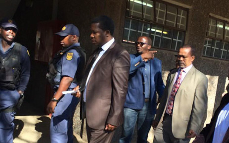 Gauteng Education MEC Panyaza Lesufi at Westbury Secondary High School with police on 5 September 2014. Picture: @EducationG