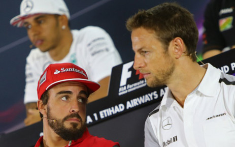 Ferraris Spanish driver Fernando Alonso (L) chats with McLaren Mercedes' British driver Jenson Button (R) as Mercedes-AMG's British driver Lewis Hamilton looks on during the press conference at the Yas Marina circuit in Abu Dhabi on November 20, 2014 ahead of the Abu Dhabi Formula One Grand Prix. Picture: AFP