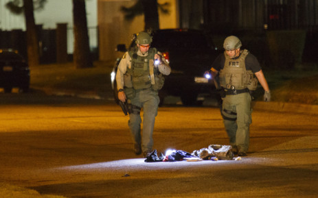 Law enforcement officers investigate a suspicious bag, later found not to be a threat, on Victoria Avenue after a mass shooting at the Inland Regional Center on 2 December, 2015 in San Bernardino, California. Picture: AFP.