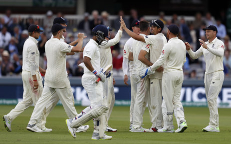 England's Alastair Cook (3R) celebrates with teammates after taking the catch to dismiss India's Ajinkya Rahane for 18 on the second day of the second Test cricket match between England and India at Lord's Cricket Ground in London on 10 August 2018. Picture: AFP.