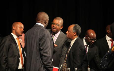 FILE: Dali Mpofu and Dumisa Ntsebeza chat during a break at the Farlam Commission of Inquiry on 3 Oct 2012. Picture: Taurai Maduna/EWN.
