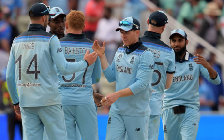England's captain Eoin Morgan (C) celebrates with his players after victory in the 2019 Cricket World Cup group stage match between England and India at Edgbaston in Birmingham, central England, on 30 June 2019. Picture: AFP