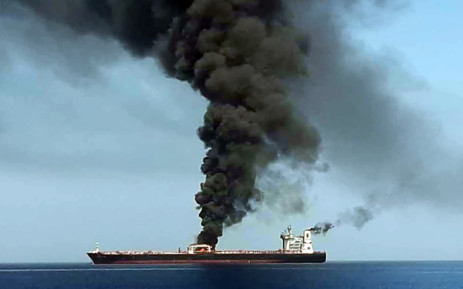 A picture obtained by AFP from Iranian State TV IRIB on 13 June 2019 reportedly shows smoke billowing from a tanker said to have been attacked off the coast of Oman, at an undisclosed location. The crews of two oil tankers were evacuated off the coast of Iran after they were reportedly attacked and caught fire in the Gulf of Oman, sending world oil prices soaring. Picture: AFP