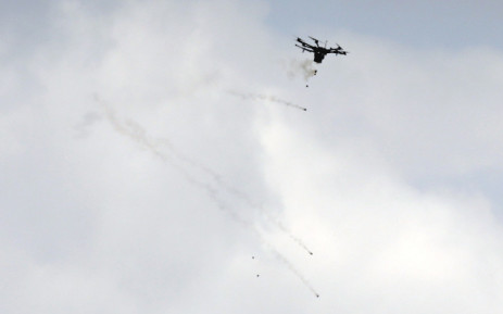 A picture taken on 30 March 2018 shows an Israeli border police drone dropping tear gas canisters during clashes with Palestinian protesters following demonstrations commemorating Land Day near the border with Israel, east of Gaza City. Picture: AFP
