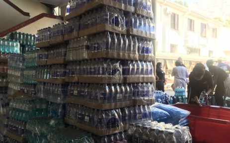 Bottles of water and energy drinks are stacked at the Roeland Street fire station in Cape Town following donations from residents and businesses to the firefighters battling the Table Mountain fire on 20 April 2021. Picture: Lizell Persens/Eyewitness News