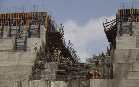 File: Ethiopian workers construct on 31 March, 2015 the Grand Renaissance Dam near the Sudanese-Ethiopian border. Ethiopia began diverting the Blue Nile in May 2013 to build the 6,000 megawatt dam, which will be Africa's largest when completed in 2017. Picture: AFP