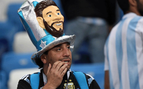 An Argentina's fan wearing a fancy hat depicting Argentina's forward Lionel Messi reacts after being defeated by Croatia at the end of the Russia 2018 World Cup Group D football match between Argentina and Croatia at the Nizhny Novgorod Stadium in Nizhny Novgorod on 21 June, 2018. Picture: AFP.