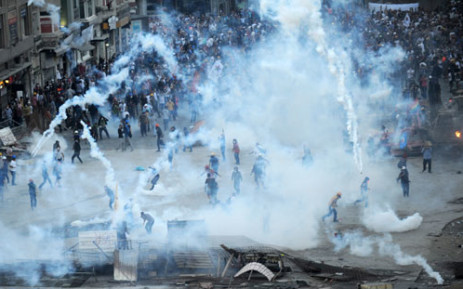 Turkish riot police fire teargas and water cannon to disperse score of protesters in Taksim Square in Istanbul over anti-government protests. Picture :AFP