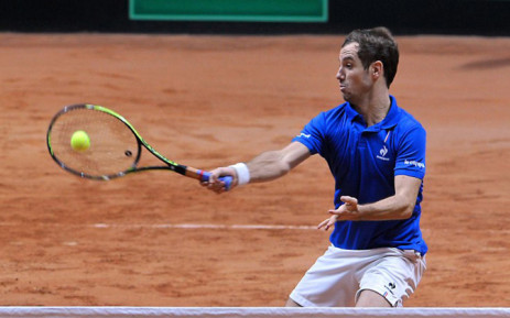 France's Richard Gasquet returns the ball during the doubles tennis match on the second day of the Davis Cup final between France and Switzerland at the Stade Pierre Mauroy in Villeneuve-d'Ascq, northern France, on November 22, 2014. Picture: AFP