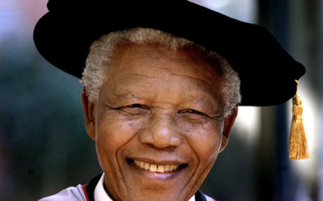 Former South African president and Nobel Peace Prize laureate Nelson Mandela wears a traditional mortar board while receiving two honourary doctorates at the Sydney University, 04 September 2000. Picture: AFP