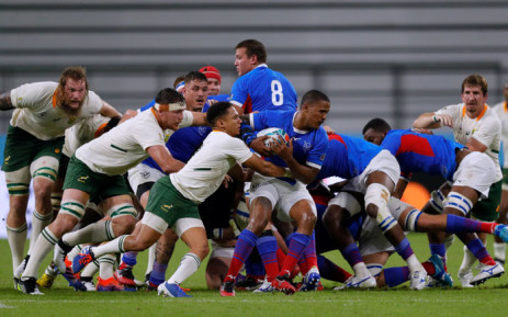 Namibia's scrum-half Eugene Jantjies (C-R) is atckled by South Africa's scrum-half Hershel Jantjies (C-L) during the Japan 2019 Rugby World Cup Pool B match between South Africa and Namibia at the City of Toyota Stadium in Toyota City on 28 September 2019.