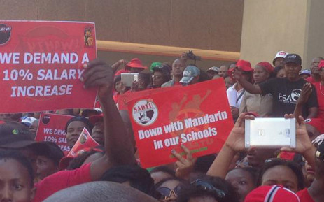 Around 10,000 people march through the Pretoria city centre calling for better wages in the public sector on 23 April 2015. Picture: Govan Whittles/EWN.