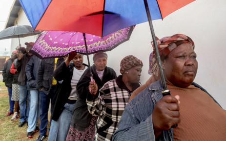 People queue to vote for South Africa's national and provincial elections at a polling station in the Tlhabologang township in Coligny on 8 May 2019. Picture: AFP