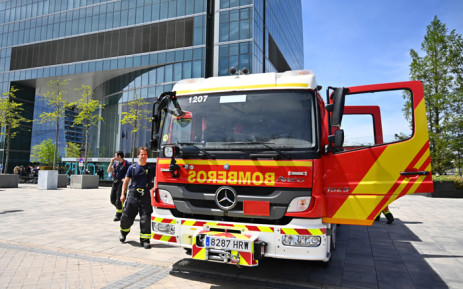 FILE: Spanish firefighters leave after inspecting a security threat at the Torre Espacio skyscraper at the Cuatro Torres (Four Towers) business park in Madrid on 16 April 2019. A skyscraper in Madrid that houses the British, Dutch, Australian and Canadian embassies was evacuated over a bomb threat, police said. Picture: AFP
