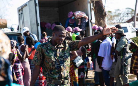 A member of the Mozambican government runs the line at the food truck in a relief camp set up for victims of Cyclone Idai. Picture: Ahmed Kajee/EWN