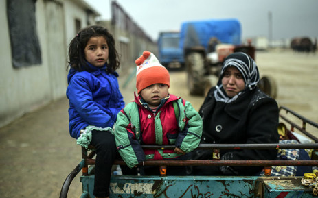 Refugee children arrive at the Turkish border crossing gate as Syrians fleeing the northern embattled city of Aleppo wait on 6 February 2016 in Bab al-Salama, near the city of Azaz, northern Syria. Picture: AFP.