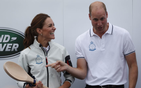 Britain's Catherine, Duchess of Cambridge (L) reacts with Britain's Prince William, Duke of Cambridge as she receives a wooden spoon for coming in last place, during the presentation ceremony following the eight boat regatta, The King's Cup at Cowes off the south coast of England on 8 August 2019. Picture: AFP