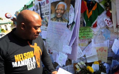 An official from the Nelson Mandela Centre of Memory collects letters and messages of support that had been delivered these past weeks at the Medi-Clinic Heart Hospital in Pretoria for former president Nelson Mandela, Monday, 8 July 2013.Picture:SAPA