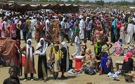 FILE: Displaced Sudan nationals queue to receive humanitarian aid supplies at the Kalma camp for internally displaced people in Darfur's state capital Niyala in October 2019. Picture: AFP.