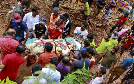 Rescue workers shift a body from the debris left after a landslide at Kavalappara in Malappuram district of the south Indian state of Kerala on 11 August 2019. Picture: AFP