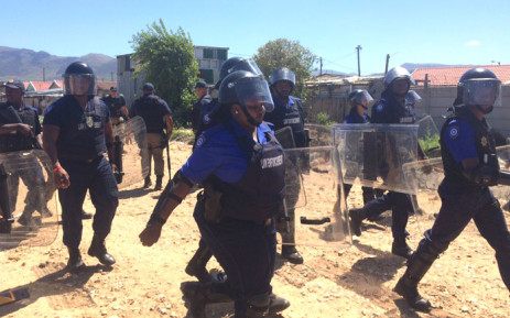 Metro Police officials armed with riot shields patrolled the area. Picture: Lauren Isaacs/EWN.
