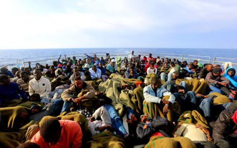 African migrants are seen on a boat trying to cross the Mediterranean. Picture: @UNmigration/Twitter.