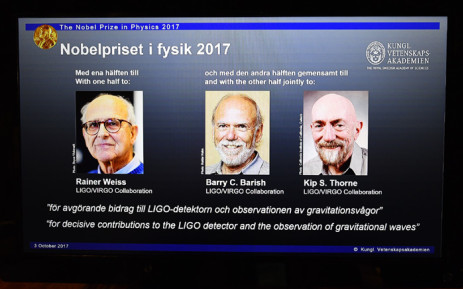 Rainer Weiss, Barry C Barish and Kip S Thorne are pictured on a display during the announcement of the 2017 Nobel Prize winners in Physics on 3 October 2017 at the Royal Swedish Academy of Sciences in Stockholm. Picture: AFP.