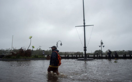 A man wades through rising flood waters on the Cape Fear River during Hurricane Florence in Wilmington, North Carolina on 14 September 2018. In the port city of Wilmington, residents awoke to the sound of power transformers blowing up, plunging homes into darkness as Hurricane Florence's howling winds whipped through the streets sending metal signs, water and debris flying. Picture: AFP