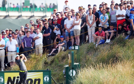 Northern Ireland's Rory McIlroy watches his tee shot during his second round 66, on day two of the 2014 British Open Golf Championship at Royal Liverpool Golf Course in Hoylake, north west England on 18 July 2014. Picture: AFP.