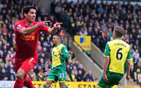 Liverpool's Uruguayan striker Luis Suarez (L) celebrates scoring a goal during the English Premier League football match between Norwich City and Liverpool at Carrow Road in Norwich on April 20, 2014. Picture: AFP.