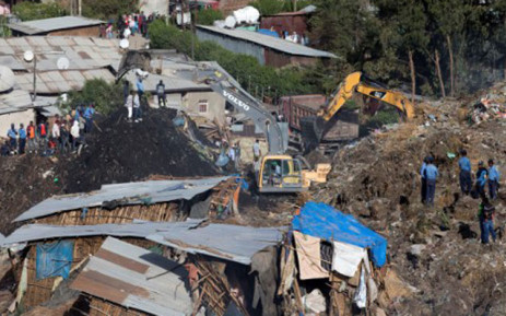 Excavators move earth as rescuers work at the site of a landslide at the main landfill of Addis Ababa on the outskirts of the city on March 12, 2017. Picture: AFP