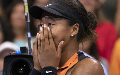 Naomi Osaka of Japan cries while being interviewed after her match against Coco Gauff of the US during their Round 3 women's Singles match at the 2019 US Open at the USTA Billie Jean King National Tennis Center in New York on 31 August. Picture: AFP