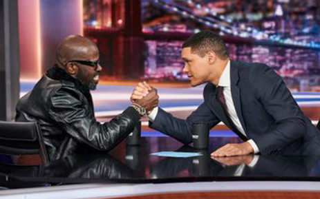DJ Black Coffee and South African comedian Trevor Noah appear to arm wrestle on The Daily Show. Picture: @RealBlackCoffee/Twitter