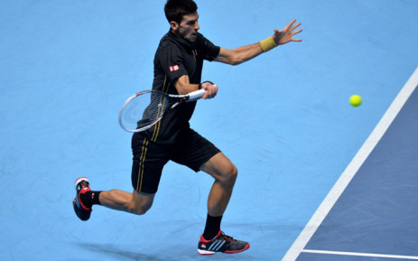 Serbia's Novak Djokovic returns to Japan's Kei Nishikori during their semi-final singles match on day seven of the ATP World Tour Finals tennis tournament in London on November 15, 2014. Picture: AFP.